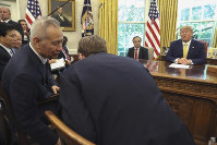 In this Oct. 11, 2019 file photo, U.S. President Donald Trump watches as Chinese Vice Premier Liu He speaks to U.S. Trade representative Robert Lighthizer, right, in the Oval Office of the White House in Washington. (AP Photo/Andrew Harnik)