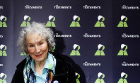 In this Sept. 10, 2019 file photo, Canadian author Margaret Atwood poses for a photograph during a press conference at the British Library to launch her new book 'The Testaments' in London. (AP Photo/Alastair Grant)