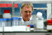 Scientist Peter J. Ratcliffe poses for photos in a laboratory at the University in Oxford, England, on Oct. 7, 2019. (AP Photo/Frank Augstein)