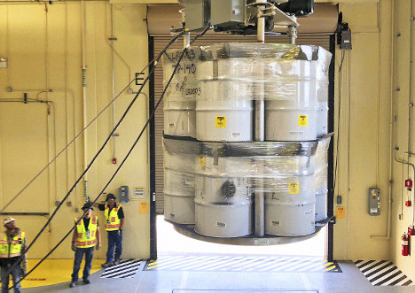 In this April 9, 2019 file photo, provided by Los Alamos National Laboratory, barrels of radioactive waste are loaded for transport to the Waste Isolation Pilot Plant, marking the first transuranic waste loading operations in five years at the Radioactive Assay Nondestructive Testing (RANT) facility in Los Alamos, N.M. (Nestor Trujillo/Los Alamos National Laboratory via AP)