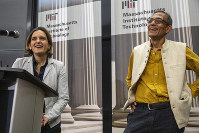 Esther Duflo, left, and Abhijit Banerjee speak during a news conference at Massachusetts Institute of Technology in Cambridge, Mass., on Oct. 14, 2019. Banerjee and Duflo, along with Harvard's Michael Kremer, were awarded the 2019 Nobel Prize in economics for pioneering new ways to alleviate global poverty. (AP Photo/Michael Dwyer)