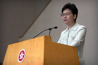 Hong Kong Chief Executive Carrie Lam speaks during a press conference at the government building in Hong Kong, on Oct. 15, 2019. (AP Photo/Mark Schiefelbein)