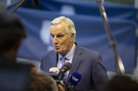European Union chief Brexit negotiator Michel Barnier speaks to the media as he arrives for a meeting of EU General Affairs ministers at the European Convention Center in Luxembourg, on Oct. 15, 2019. (AP Photo/Virginia Mayo)