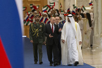 Russian President Vladimir Putin, foreground left, and Abu Dhabi Crown Prince Mohamed bin Zayed al-Nahyan, right, attend the official welcome ceremony in Abu Dhabi, United Arab Emirates, on Oct. 15, 2019. (AP Photo/Alexander Zemlianichenko, Pool)