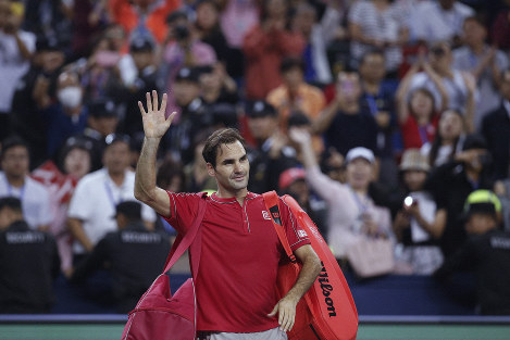 Roger Federer of Switzerland waves to spectators as he leaves the court after he lost to Alexander Zverev of Germany in their men's singles quarterfinals match at the Shanghai Masters tennis tournament at Qizhong Forest Sports City Tennis Center in Shanghai, China, on Oct. 11, 2019. (AP Photo/Andy Wong)
