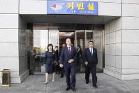 FIFA President Gianni Infantino, center, arrives at Pyongyang Airport in Pyongyang, North Korea, on Oct. 15, 2019. (AP Photo/Jon Chol Jin)