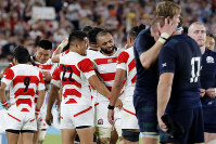 Japan's Michael Leitch, center, celebrates with teammates after winning over Scotland in the Rugby World Cup Pool A game at International Stadium in Yokohama, Japan, on Oct. 13, 2019. (AP Photo/Eugene Hoshiko)