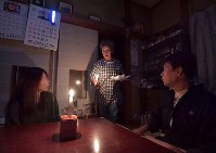 Residents use candles in their house in the northeastern Japan city of Marumori, Miyagi Prefecture, on Oct. 15, 2019, after a power blackout in the area caused by Typhoon Hagibis. (Mainichi/Yoshiyuki Hirakawa)