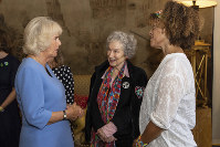 Britain's Camila The Duchess of Cornwall talks with 2019 Booker prize joint winners Margaret Atwood, centre, and Bernardine Evaristo, right, during a reception for the Booker Prize Foundation at Clarence House in London, on Oct. 15, 2019. (Aaron Chown/PA via AP)