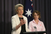 Australian Agriculture Minister Bridget McKenzie, left, and pork industry executive Margo Andrae address the media at Parliament House in Canberra, Australia on Oct. 15, 2019, on the threat of African swine fever. (AP Photo/Rod McGuirk)