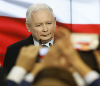 Leader of Poland's ruling party Jaroslaw Kaczynski speaks in reaction to exit poll results right after voting closed in the nation's parliamentary election that is seen crucial for the nation's course in the next four years, in Warsaw , Poland, on Oct. 13, 2019. (AP Photo)