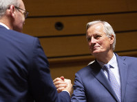 European Union chief Brexit negotiator Michel Barnier, right, shakes hands with Irish Foreign Minister Simon Coveney during a meeting of EU General Affairs ministers, Article 50, at the European Convention Center in Luxembourg, on Oct. 15, 2019. (AP Photo/Virginia Mayo)