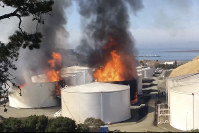 In this image from video provided by the Napa County Sheriff's Office, tanks are on fire at an oil storage facility on Oct. 15, 2019, viewed from Rodeo, Calif. (Henry Wofford/Napa County Sheriff's Office via AP)