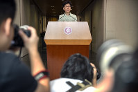 Journalists take photos as Hong Kong Chief Executive Carrie Lam speaks during a press conference at the government building in Hong Kong, on Oct. 15, 2019. (AP Photo/Mark Schiefelbein)