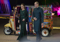 Britain's Prince William and his wife Kate arrive in a traditionally painted motorized rickshaw to attend a reception in Islamabad, Pakistan, on Oct. 15, 2019. (AP Photo/B.K. Bangash)
