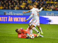 Spain's Thiago Alcantara tries to go for a goal but Sweden's goalkeeper Robin Olsen saves the attempt during their Euro 2020 Group F qualification soccer match between Sweden and Spain at Friends Arena in Solna, Stockholm, Sweden, on Oct. 15, 2019.(Anders Wiklund / TT via AP)