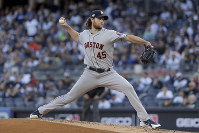 Houston Astros starting pitcher Gerrit Cole (45) delivers against the New York Yankees during the first inning of Game 3 of baseball's American League Championship Series, on Oct. 15, 2019, in New York. (AP Photo/Frank Franklin II)