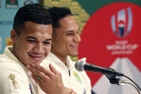 South Africa rugby team players, Cheslin Kolbe, left, and Herschel Jantjies, right, attend a press conference in Tokyo, Wednesday, Oct. 16, 2019. South Africa and Japan will play in the Oct. 20 quarterfinal at the Rugby World Cup. (AP Photo/Koji Sasahara)