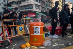 習政権への批判は香港にも拡大 Bloomberg