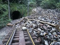 Fallen rocks cover train tracks near Ohiradai Tunnel between Ohiradai and Miyanoshita stations. (Photo courtesy of Hakone Tozan Railway Co.)