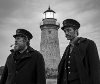 This image released by A24 Films shows Willem Dafoe, left, and Robert Pattinson in a scene from 'The Lighthouse.' (Eric Chakeen/A24 Pictures via AP)