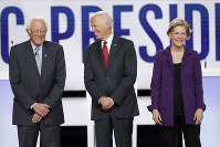 Democratic presidential candidate Sen. Bernie Sanders, I-Vt., former Vice President Joe Biden, center, and Sen. Elizabeth Warren, D-Mass., right, stand on stage before a Democratic presidential primary debate hosted by CNN and The New York Times at Otterbein University, on Oct. 15, 2019, in Westerville, Ohio. (AP Photo/John Minchillo)