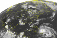 This Aug. 24, 2011 NOAA satellite image shows Hurricane Irene, a category 2 storm with winds up to 100 mph and located about 400 miles southeast of Nassau. (Weather Underground via AP)