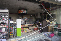 Debris are scattered on the floor of a damaged store a day after a strong quake struck in Digos, Davao del Sur province, southern Philippines on Oct. 17, 2019. (AP Photo)