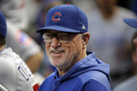In this Sept. 25, 2019, file photo, then-Chicago Cubs manager Joe Maddon stands in the dugout before a baseball game against the Pittsburgh Pirates, in Pittsburgh. (AP Photo/Gene J. Puskar)