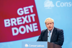 保守党大会でEU離脱の新提案を発表したジョンソン英首相=10月2日(Bloomberg)