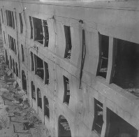 The walls of the then Honkawa national elementary school building are seen bent by the impact of the atomic explosion in the city of Hiroshima, in this photo taken by Kiyoshi Kanai and Toshio Maeda.