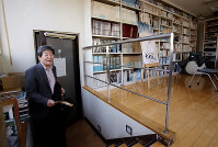 In this Feb. 12, 2015 file photo, co-founder of Japan's prestigious Studio Ghibli, Isao Takahata, appears in his office at Studio Ghibli in suburban Tokyo after an interview about his animated film