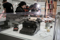 A typewriter, tobacco pipes, and eye glasses are part of a J.D. Salinger exhibit being installed at the New York Public Library on Oct. 16, 2019, in New York. (AP Photo/Bebeto Matthews)