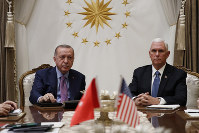 Vice President Mike Pence, right, meets with Turkish President Recep Tayyip Erdogan at the Presidential Palace for talks on the Kurds and Syria, on Oct. 17, 2019, in Ankara, Turkey. (AP Photo/Jacquelyn Martin)