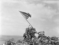 In this Feb 23, 1945 file photo, U.S. Marines of the 28th Regiment, 5th Division, raise the American flag atop Mt. Suribachi, Iwo Jima, Japan. (AP Photo/Joe Rosenthal)