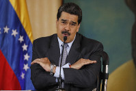 In this Sept. 30, 2019, file photo, Venezuela's President Nicolas Maduro speaks during a press conference at the Foreign Ministry in Caracas, Venezuela. (AP Photo/Ariana Cubillos)