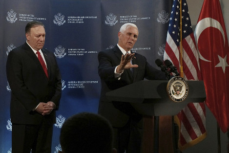 U.S Vice President Mike Pence, right, speaks at the U.S. ambassador's residence during a news conference with Secretary of State Mike Pompeo after their meeting with Turkish President Recep Tayyip Erdogan, in Ankara, Turkey, on Oct. 17, 2019. (AP Photo/Burhan Ozbilici)