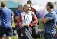 England rugby coach Eddie Jones, center, smiles as he talks during training at Beppu, Japan, on Oct. 15, 2019. (AP Photo/Aaron Favila)