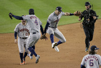 Houston Astros center fielder George Springer (4) and shortstop Carlos Correa (1) celebrate after the Astros beat the New York Yankees 8-3 in Game 4 of baseball's American League Championship Series on Oct. 18, 2019, in New York. (AP Photo/Seth Wenig)
