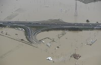 The Mito-Kita Interchange in the eastern Japan city of Mito is seen submerged under water that overflowed from the Naka River on Oct. 14, 2019. (Mainichi)