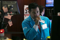 In this Oct. 2, 2019, file photo specialist William Geier works on the floor of the New York Stock Exchange. (AP Photo/Richard Drew)