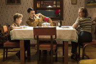 This image released by Fox Searchlight Pictures shows, from left, Roman Griffin Davis, Taika Waititi and Scarlett Johansson in a scene from the WWII satirical film 'Jojo Rabbit.' (Kimberley French/Fox Searchlight Pictures via AP)