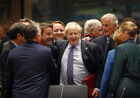 British Prime Minister Boris Johnson, center, is greeted by Luxembourg's Prime Minister Xavier Bettel, center left, during a round table meeting at an EU summit in Brussels, on Oct. 17, 2019. (AP Photo/Frank Augstein)