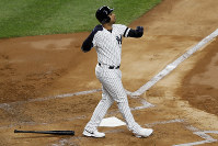 New York Yankees' Aaron Hicks watches his three-run home run against the Houston Astros during the first inning in Game 5 of baseball's American League Championship Series on Oct. 18, 2019, in New York. (AP Photo/Kathy Willens)