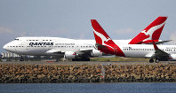 In this Aug. 20, 2015 file photo, two Qantas planes taxi on the runway at Sydney Airport in Sydney, Australia. Australia's Qantas has completed the first non-stop commercial flight from New York to Sydney Sunday, Oct. 20, 2019, which was used to run a series of tests to assess the effects of ultra-long-haul flights on crew fatigue and passenger jetlag. (AP Photo/Rick Rycroft)