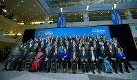 International Monetary Fund (IMF) Governors gather for a group photo during the World Bank/IMF Annual Meetings in Washington, Saturday, Oct. 19, 2019. (AP Photo/Jose Luis Magana)