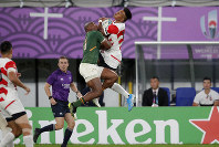 Japan's Kotaro Matsushima, right, and South Africa's Makazole Mapimpi battle for the ball during the Rugby World Cup quarterfinal match at Tokyo Stadium between Japan and South Africa in Tokyo, Japan, Sunday, Oct. 20, 2019. (AP Photo/Jae C. Hong)