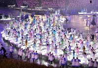 2012 London Olympics -- A performance is seen as part of the opening ceremony. Japan marked 100 years since it participated in the Olympics for the first time at the 1912 Stockholm Games. Japan appeared at the Olympics in London for the first time after it was not invited to the 1948 event in the city, which had previously hosted the 1908 Summer Olympics. A total of 204 nations and regions marched in the opening ceremony, including 76 members of the Japanese delegation led by flag bearer Saori Yoshida.