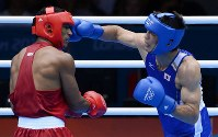 2012 London Olympics -- Japan's Ryota Murata punches Brazil's Esquiva Falcao on his way to securing the gold medal in the final of the middleweight class in men's boxing. Murata became the second Japanese gold medalist in boxing after Takao Sakurai, who won the bantamweight class in the 1964 Tokyo Games. (Mainichi/Masaru Nishimoto)