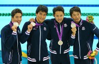 2012 London Olympics -- The Japanese swimming team shows off the silver medals they won in the men's 400-meter medley relay. From right, Ryosuke Irie, Kosuke Kitajima, Takeshi Matsuda and Takuro Fujii are seen. Kitajima raised his fist several times and commented,